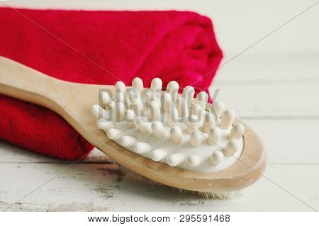 Wooden Brush For Body Massage And Red Bath Towel On Wooden Background. Body Care
