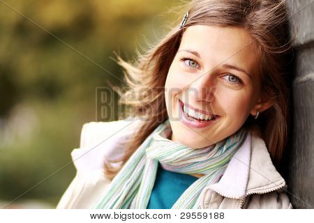 Closeup portrait of a happy young woman smiling