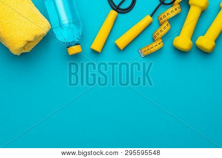 Flat Lay Photo Of Fitness Equipment. Top View Of Yellow Fitness And Street Workout Objects. Yellow F