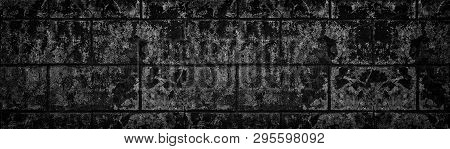 Wide Black Shabby Concrete Wall Texture. Dark Old Cracked Cement Surface Panorama. Grunge Panoramic