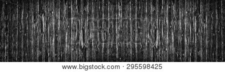 Wide Old Black Knotty Wood Texture. Dark Plank Rough Surface Panorama. Wooden Board Panoramic Backgr