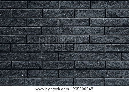 Texture Of Dark Gray Brick Wall. The Wall Is Tiled Decorative. Dark Stone Background Of House Facade