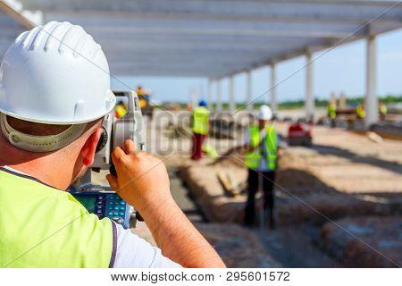 Surveyor Engineer Is Measuring Level On Construction Site. Surveyors Ensure Precise Measurements Bef