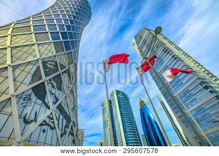 Doha, Qatar - February 17, 2019: Tornado Tower With Image Of Emir Tamim Bin Hamad Al-thani And Flag