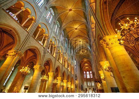 Paris, France - July 1, 2017: Interior Colonnade Panorama Of Notre Dame Gothic Cathedral Left Side N