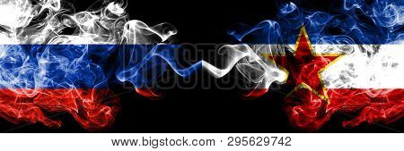 Russian Vs Yugoslavia Smoke Flags Placed Side By Side. Thick Colored Silky Smoke Flags Of Russia And