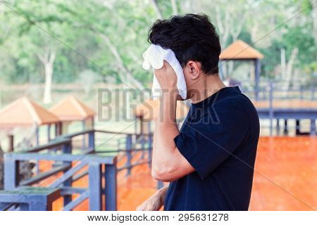 Man Wiping Off The Sweat In The Parks.