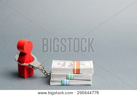 A Red Man Is Handcuffed To A Money. Dependence On Finance. Accumulated Debts. Inability To Repay Loa