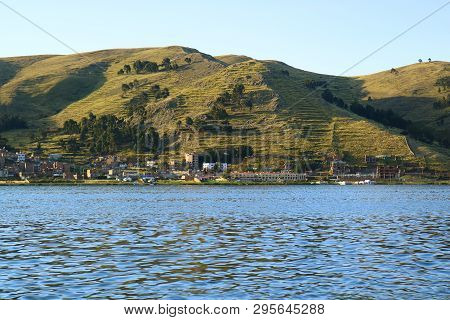 Puno Town On The Shore Of Lake Titicaca View From Cruise Ship, Puno, Peru