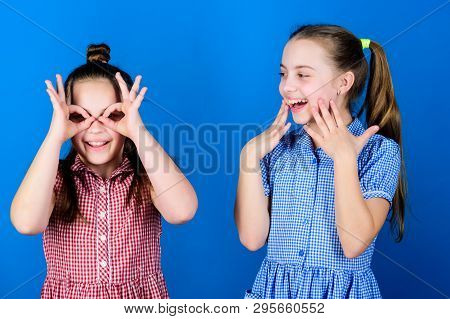 Its Funny. Funny Children. Funny Little Girls Enjoy Playing Together. Small Kids Gesturing And Makin