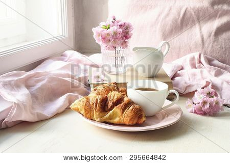 Spring Still Life Scene. Cup Of Coffee, Croissant Pastry, Old Books And Milk Pitcher. Vintage Femini