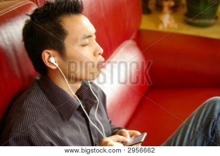 Asian Man Listenning To Music
