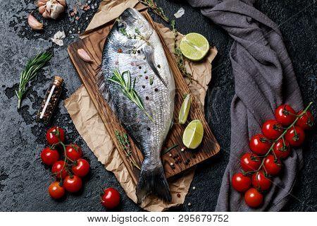 Fresh Fish Dorado. Raw Dorado Fish And Ingredient For Cooking. Fresh Fish Gilt-head Bream Dorade Wit