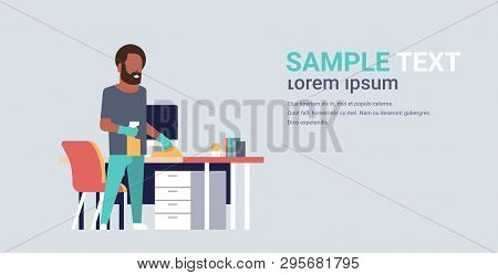 Man Cleaning Computer Table With Duster African American Guy Wiping Workplace Desk Housework Concept