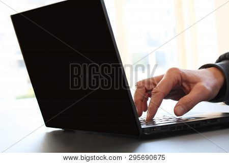 Closeup Image Of A Finger Touching Texting On Keyboard On A Laptop Computer. Stock Photo With White