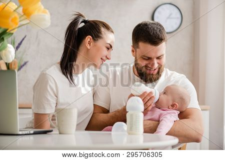 Feeding Baby Girl With Formula In A Bottle.