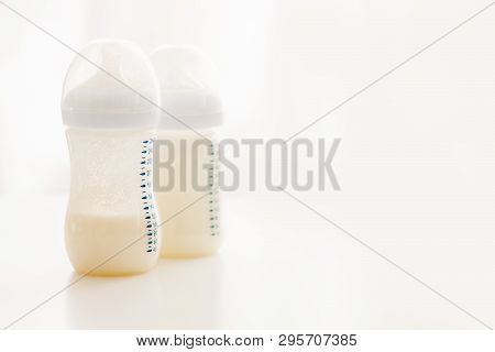 Two Plastic Bottles With Baby Milk Formula