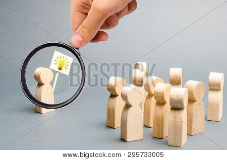Magnifying Glass Is Looking At A Man With A Poster With A Picture Of The Bulb
