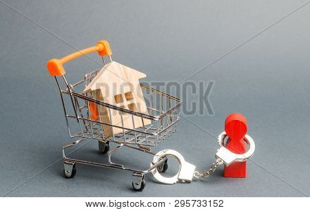 A Person Is Handcuffed To A House On A Supermarket Cart. Financial Dependence, Unavailable Housing F