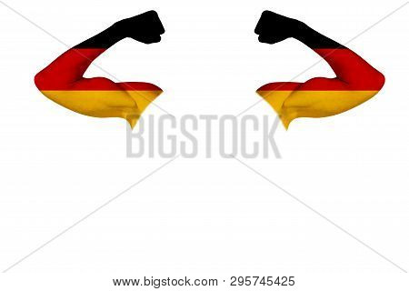 Two Carved Hands With A Painted Flag Of Germany Show Muscles As A Sign Of Strength, Strength And Rea