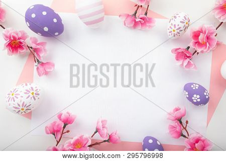 Easter Eggs On Pink Background. Spring Flowers For Happy Easter Card