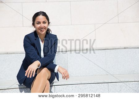 Happy Cheerful Professional Enjoying Work Break Outdoors. Positive Young Woman In Formal Suit Sittin