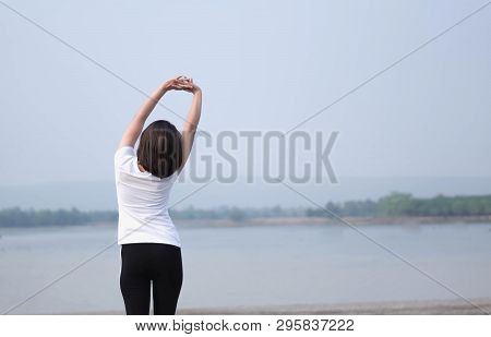 Closeup Woman Warm Up And Stretching Exercises For Running With Nature Background, Vintange Tone