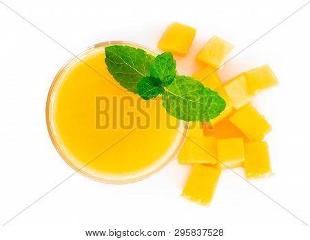 Closeup Glass Of Mango Fruit Juice Isolated On White Background