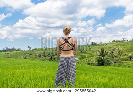 Relaxed Casual Sporty Woman Enjoying Pure Nature At Beautiful Green Rice Fields On Bali.