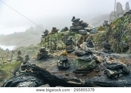 Stones Stacked For Norwegian Fairytale Trolls. Relief And Texture Of Stone With Patterns And Moss. S