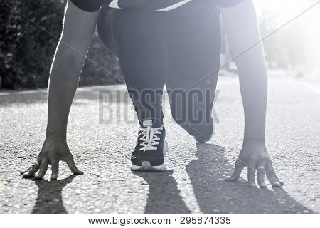 Girl About To Start Running And Racing Outdoors