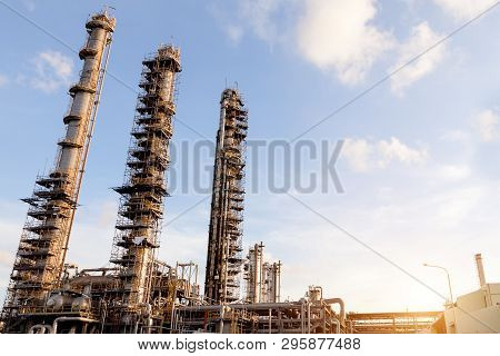 Petrochemical Oil Refinery Factory Plant. Column Tower In Petrochemical Plant And Blue Sky. Refinery