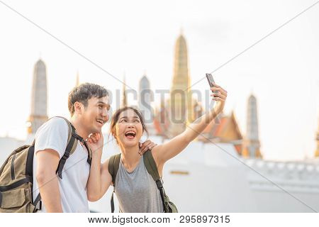 Asian Blogger Couple Travel In Bangkok, Thailand, Sweet Couple Using Mobile Phone Selfie And Photo V