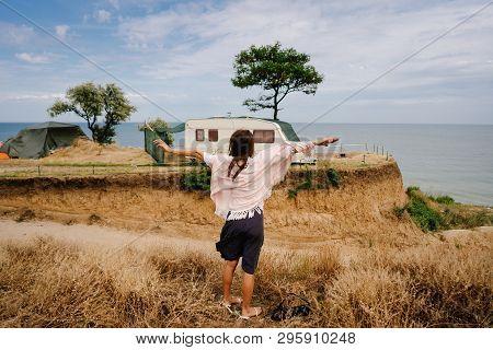 Beautiful, Young Girl Posing On A Wild Seashore