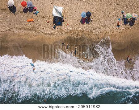 Beach With Sun Loungers On The Coast Of The Ocean