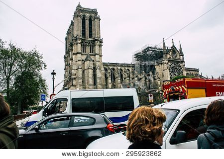 Paris France April 16, 2019  View Of Parisians And Tourists Come To See The Notre Dame Cathedral Whi