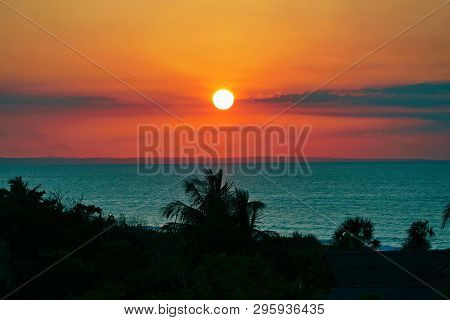 Sunset And Sea With Silhouette Palm Trees