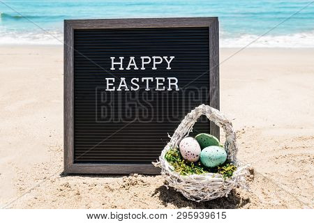 Happy Easter Beach Background With Black Board And Eggs Near Ocean