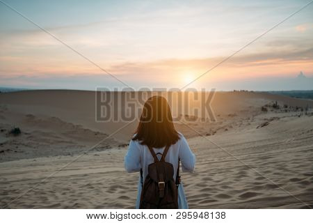 Young Woman Traveler Traveling Into White Sand Dunes At Mui Ne In Vietnam At Sunrise With Beautiful