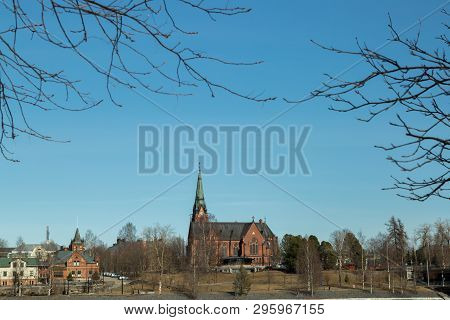 The Church In Umea, Sweden In Spring With A Clear Blue Sky.