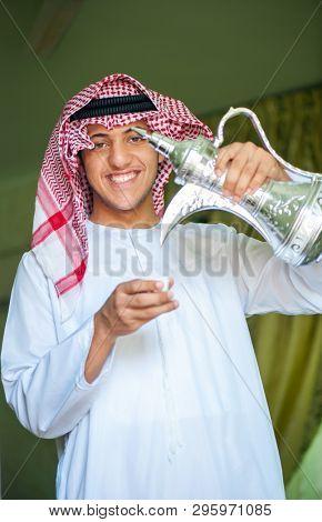 Arbic boy pouring coffee