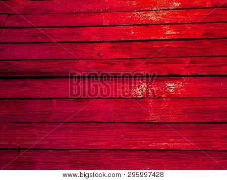 Bright Red Fence. Orange Color Fence Boards.