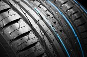 Car tire. Tire stack. Car tyre protector close up. Black rubber tire. Brand new car tires. Close up black tyre profile. Car tires in a row poster