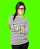 portrait of a young happy woman posing against a removable chroma key background poster