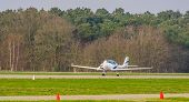 white stunt airplane taking off, recreational air transportation poster