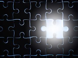 Missing Jigsaw Puzzle Piece With Lighting, Business Concept For Completing The Finishing Puzzle Piec