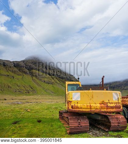Old Ruined Excavator Abandoned Near The Mountains