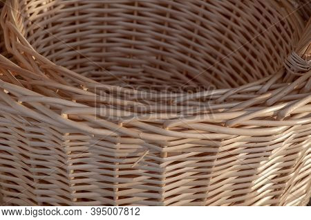 Wooden Wickerwork With Yellow Straws. Wooden Basket Background Texture