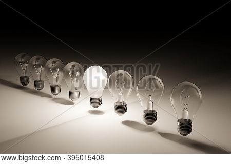 Line Of Light Bulbs With Middle Light Bulb Lit. 3d Rendering.