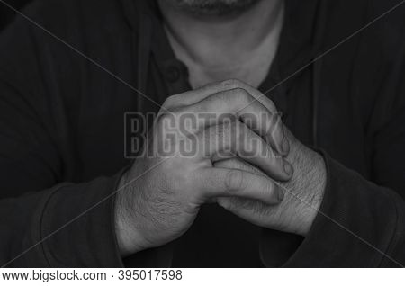 Kung Fu Hand Salutation With Fist And Palm. Adult Man Depicts Ritual Of Welcome In Martial Arts With